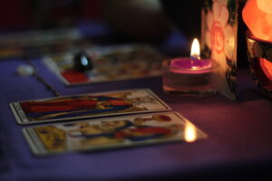 Photo of tarot cards with candels