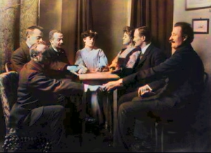 Vintage picture of people seated around a seance table